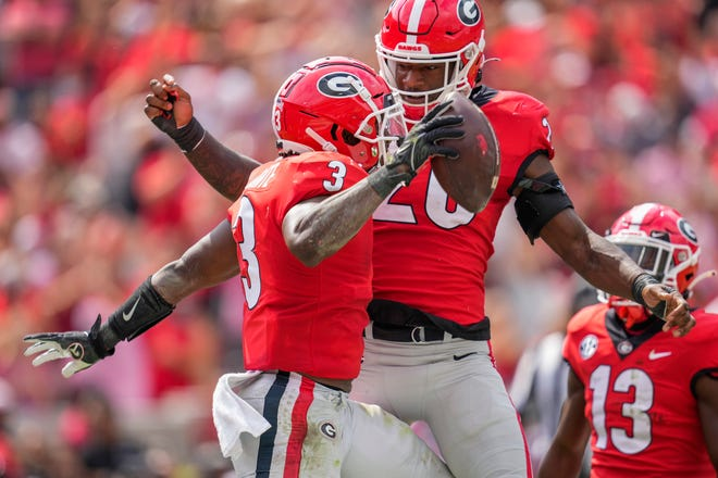 Georgia running back Zamir White celebrates after recovering a blocked punt for a touchdown during the No. 2 Bulldogs' win against the Arkansas Razorbacks.