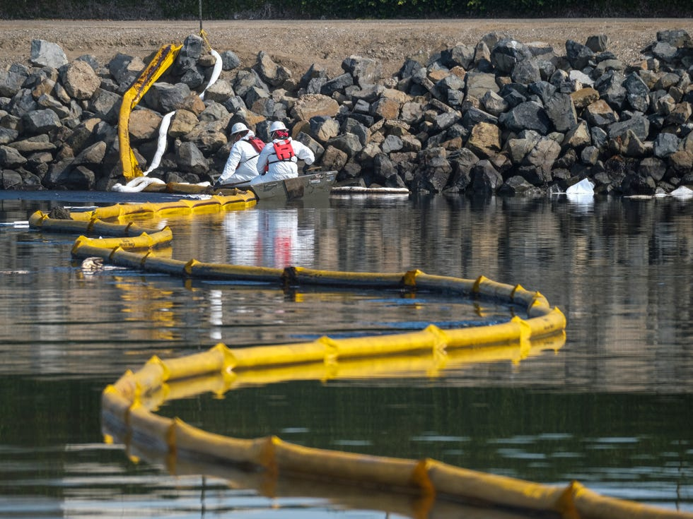 Crews deploy skimmers and floating barriers known as booms to try to stop further incursion into the Wetlands Talbert Marsh in Huntington Beach, Calif., Sunday., Oct. 3, 2021. One of the largest oil spills in recent Southern California history fouled popular beaches and killed wildlife while crews scrambled Sunday to contain the crude before it spread further into protected wetlands.