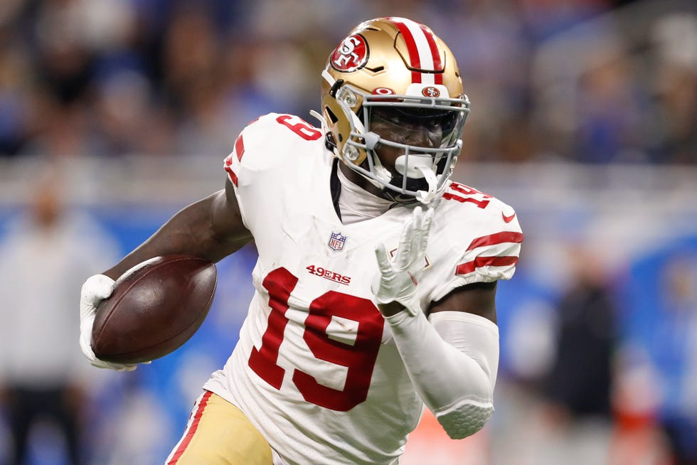 Sep 12, 2021; Detroit, Michigan, USA; San Francisco 49ers wide receiver Deebo Samuel (19) runs with the ball during the second quarter against the Detroit Lions at Ford Field.