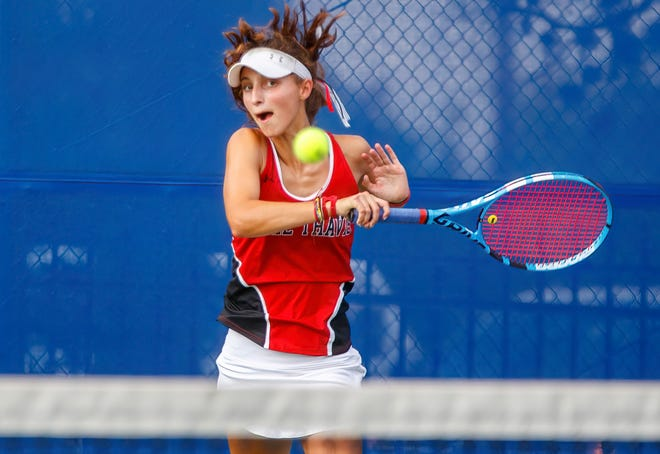 Lake Travis' Jacqueline Creel returns the ball against Westlake during girls doubles match at the District 26-6A tennis match on Sept. 28 at Westlake High School. The Chaps won the battle between the two state-ranked teams 16-9 to claim the top seed at this week's District 26-6A tournament.