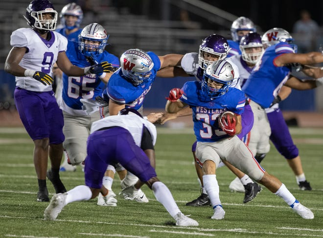 Westlake sophomore running back Jackson Kayser, right, finds some room to run in Friday's win over San Marcos. Kayser started the game in place of Hunter Henault and ran eight times for 48 yards and two touchdowns. Westlake coach Todd Dodge says getting reserves ample playing time, especially with the first team, will prove beneficial in the postseason.