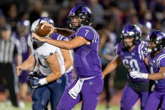 Cedar Ridge quarterback Aidan Liston looks to throw against Stony Point during a District 25-6A high school football game at Dragon Stadium on Friday. Liston and the Raiders stayed unbeaten in district play with a 34-0 win.