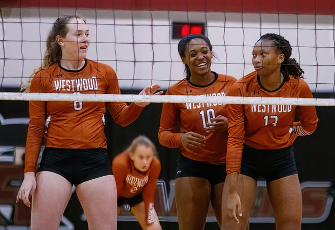 Westwood players, from left, Erin Fagan, Peyton Ferree and Trinity Woods line up at the net against Dripping Springs early in the season. The trio helped Westwood hand rival Round Rock its first loss in District 25-6A action Friday.