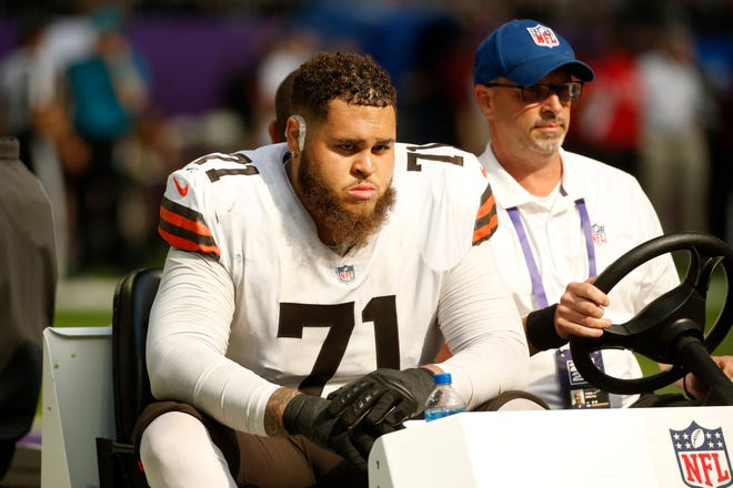 Cleveland Browns offensive tackle Jedrick Wills (71) is carted off the field after getting injured during the second half of an NFL football game against the Minnesota Vikings, Sunday, Oct. 3, 2021, in Minneapolis. [Bruce Kluckhohn/Associated Press]