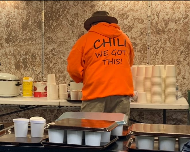 A past Homeworth Community Group chili social event included this chili fan, who is serving himself a cup of the signature recipe chili. This year's event will be Oct. 16.