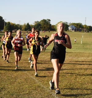 Baylie Janssen competes at the Nevada Invitational for the Roland-Story girls' cross country team Monday at the Indian Creek Country Club in Nevada. The Norse girls placed third.
