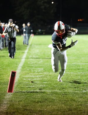 Roland-Story receiver Gavin Carpenter heads toward the end zone on a touchdown reception during the Norsemen's 46-28 loss to Iowa Falls-Alden Friday in Story City.