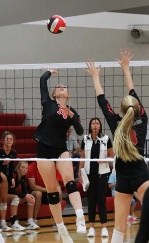 Roland-Story's Victoria Olson attempts a kill against South Hardin during the championship game of the Norsemen Invitational Sept. 27 in Story City.