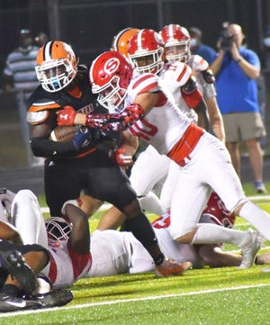 Screven County defensive lineman Luke McFarland grabs hold of Metter running back Kaliq Jordan during the Gamecocks' 41-0 Oct. 1 road loss to its region opponent. Metter is the No. 4 ranked team in the state.