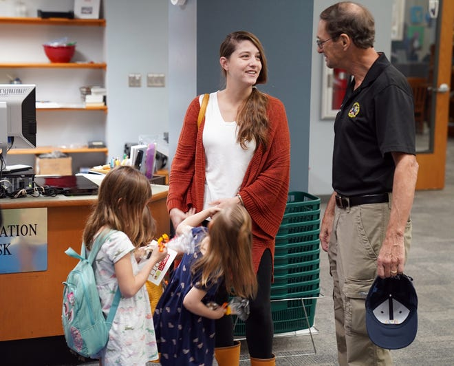 Crestview Mayor JB Whitten chats with a patron during the sneak peek evening Sept. 17 at the Crestview Public Library.