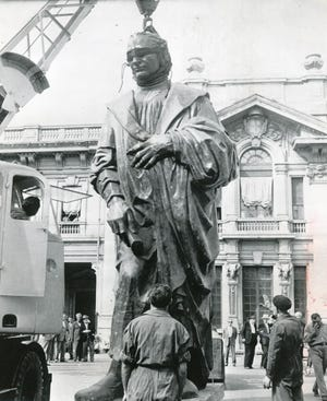The Christopher Columbus statue is shown in Italy being readied for a trip aboard the Italian liner Cristoforo Colombo for shipment to the United States in 1955.