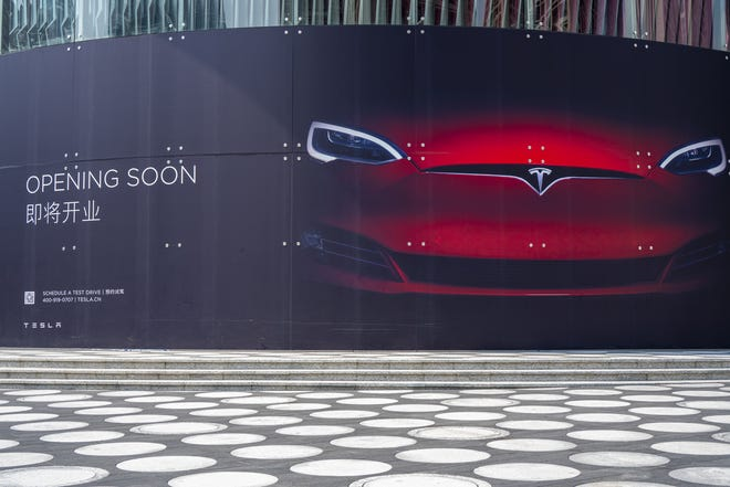 A Tesla advertisement in Shenzhen, China, October 2019. Tesla's third-quarter sales were much higher than expected. (Dreamstime.com/TNS)