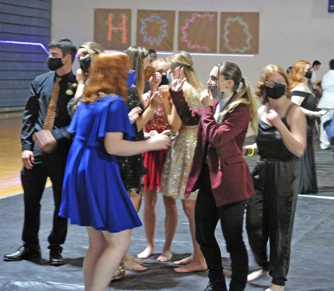 Dancing, talking and masks were a part of Wooster High School's homecoming dance Oct. 2.