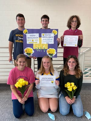 Wooster Key Club members Katherine Sayre (front left), Sheridan Schauer, Shila Thellman, Seth Opatz (back left), Justin Parks and Gabriel Cosson-Martinez will be on hand at Friday's football game to take donations for the Yellow Tulip Project