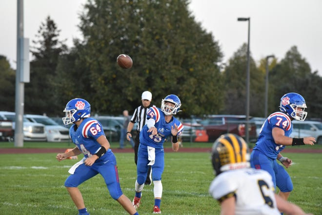 Lenawee Christian quarterback Ashur Bryja throws a pass during a game against Climax Scotts. [Telegram photo by Deloris Clark-Osborne]