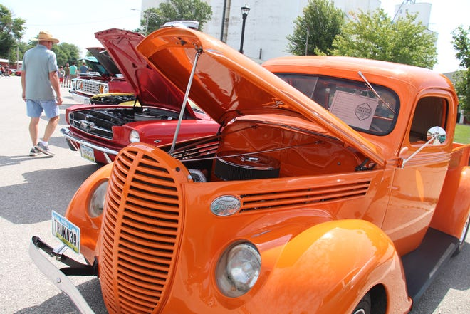 Visitors check out the vehicles lined up on Walnut Street during the Dallas Center Fall Festival on Aug. 28. Vehicles will be on display in Perry on Saturday, Oct. 9 during the PerryDice Cruizers Car Show.