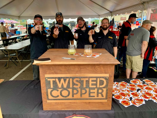 From left, Forrest Cheney, Dave Weaverling, Jonathon Hatcher and Brett McDavid of Twisted Copper, Mt. Pleasant's newest brewery, previews their beers prior to opening later this year at the second annual Columbia Oktoberfest.