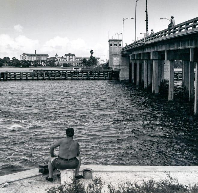 Fisherman John Dalena contemplates the Ormond Beach drawbridge.