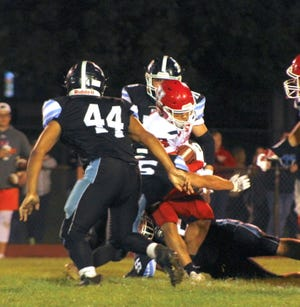 Hornell's Xzaiver Patrick fights through multiple defenders on Saturday evening against Midlakes.