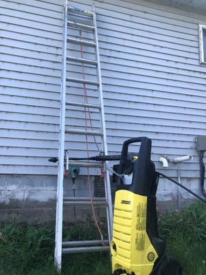 Every fall, Jerry Nelson uses a power washing and ladder to remove spiderwebs and flyspecks from the exterior of his home.