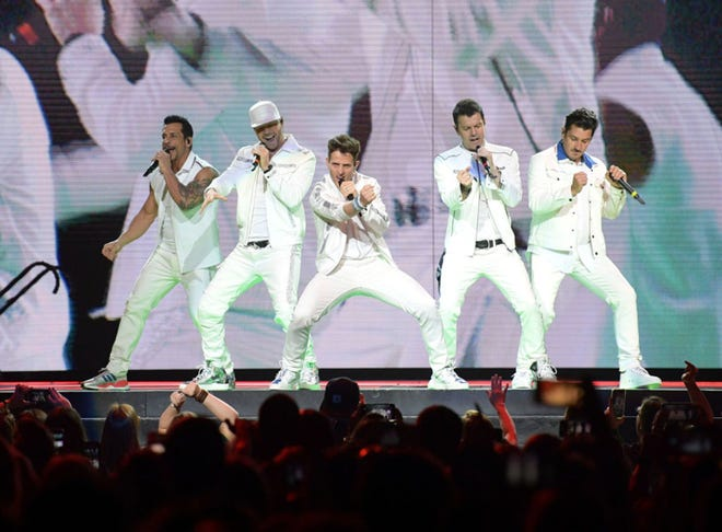 New Kids on the Block -- made up of Danny Wood (from left), Donnie Wahlberg, Joey McIntyre, Jordan Knight and Jonathan Knight -- will bring their MixTape Tour 2022 to Jacksonville's VyStar Veterans Memorial Arena in July. They're shown here performing in May 2019 in Nashville, Tenn.