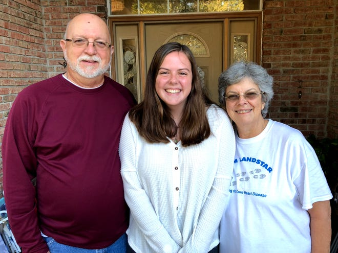 The author (center), is pictured with her grandparents, Steve and Susan Ramsey in January 2019 on the front porch of their Jacksonville Beach home. After Steve Ramsey's death later that year, Susan Ramsey has finally sold their home of 20 years and is returning to Kentucky.