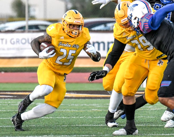 Garden City Community College running back William Knight, left, breaks up the middle off a block by lineman Carter Habich for a 77-yard touchdown run against Hutchinson Saturday at Broncbuster Stadium.  The fourth quarter doomed GCCC again, losing 24-16 to the Blue Dragons.