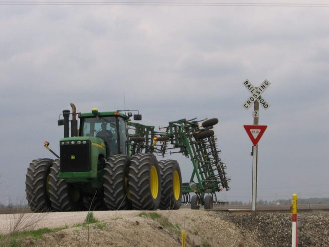 It's important for farm equipment operators and other motorists to pay attention at railroad crossings and only cross the tracks when it's safe.