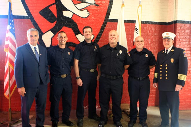 Pictured are, from left, Mayor Dean Mazzarella, Lt. Paul Apollonio, Lt. Shawn McKenna, Lt. Jay Lucier, Lt. Jeremy Murphy and Leominster Fire Chief Robert Sideleau II.