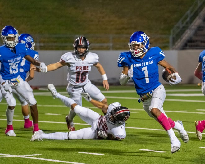 Midlothian's Xavionte Jackson finds running room during Friday night's District 4-5A (I) game against Colleyville Heritage at MISD Multipurpose Stadium.