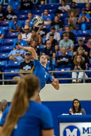 Midlothian's Lauren Safrit (2) goes up for a hit during a recent home volleyball match.
