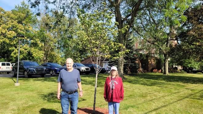 Elm House residents Robert Bulmon and Michelle Parriet were recognized by Jack Schwab for watering the tree all summer.
