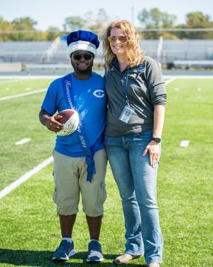 Kamari Deshields of Brownstown Township was crowed homecoming king. He is the son of Tanika and Martinez Deshields. Pictured with the king is Jessica Shultz, Carlson principal. Courtesy photo