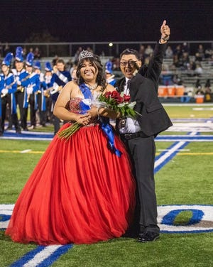 Sarah Sales of Woodhaven was recently crowned homecoming queen at Carlson High School.  She is the daughter of Roderico and Mary Jean Sales. Pictured next to Sarah is her father.    Courtesy photo