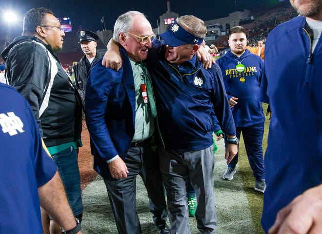 Notre Dame Athletic Director Jack Swarbrick and head coach Brian Kelly celebrate a win at USC in this 2018 file photo. After last week's 24-13 loss to No. 5 Cincinnati, the Irish need to find a way to win on the road at Virginia Tech.