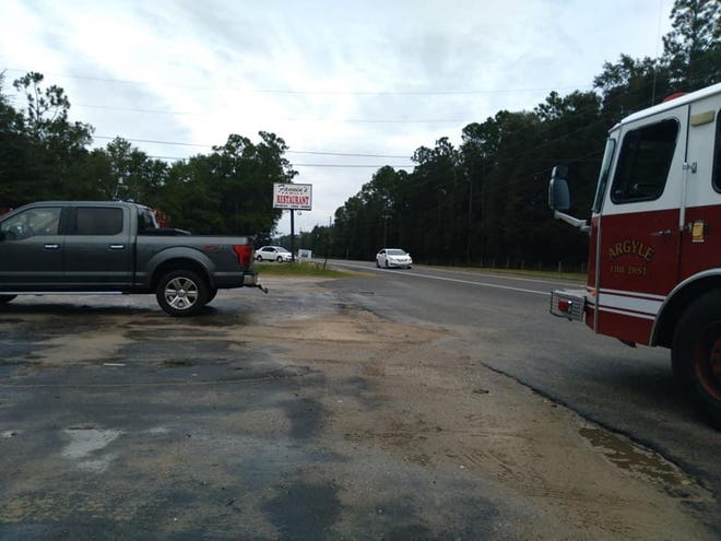 Firefighters with the Argyle Volunteer Fire Department arrive at a DeFuniak Springs restaurant Sunday morning. The grease fire had been extinguished before they arrived, but one person was taken to an area hospital to be evaluated.