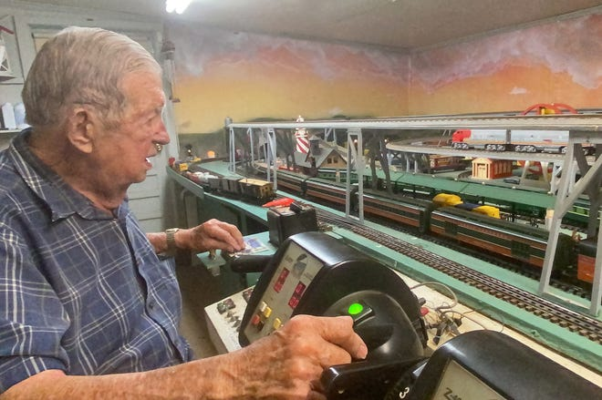V.J. Vicknair watches over the operation of trains on the model railroad at his Plaquemine home. At 89, it's an activity that keeps him busy daily.