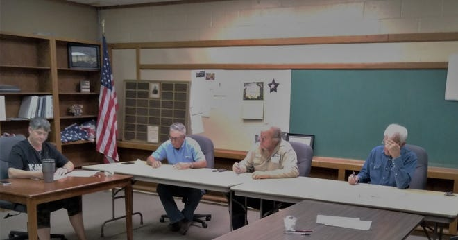 Shari Hall, Tom Daniels (council president), Andy Kimble (mayor), and Dee McDonald lead Mullinville city discussions on the plan to fix the old high school building in town.
