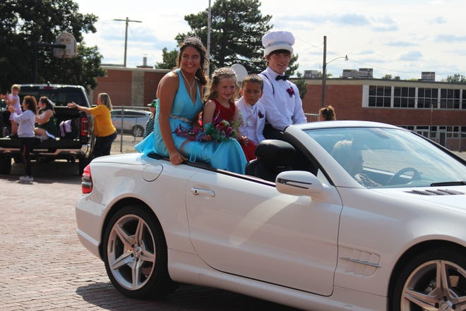 Addie Hoeme, Pratt High School 2021 Homecoming Queen and Liam Primrose, King, were joined by royal youngsters Dani Thompson and Kacin Strong for a special ride in the Friday afternoon homecoming parade in Pratt.