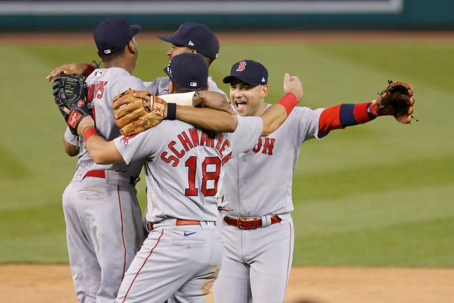 Red Sox players celebrate clinching a Wild Card berth after the final out against the Washington Nationals at Nationals Park on Sunday. Boston will host the New York Yankees Tuesday night for the right to advance to the Division Series.