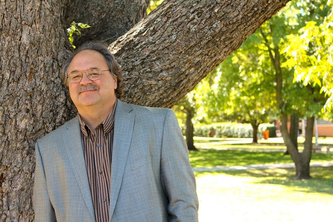 Dr. Ken Hada, an English professor at East Central University, has just published his ninth collection of original poetry titled Contour Feathers.