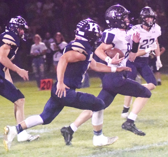 Annawan-Wethersfield's Dillon Horrie runs for a long gain against Knoxville Friday.
