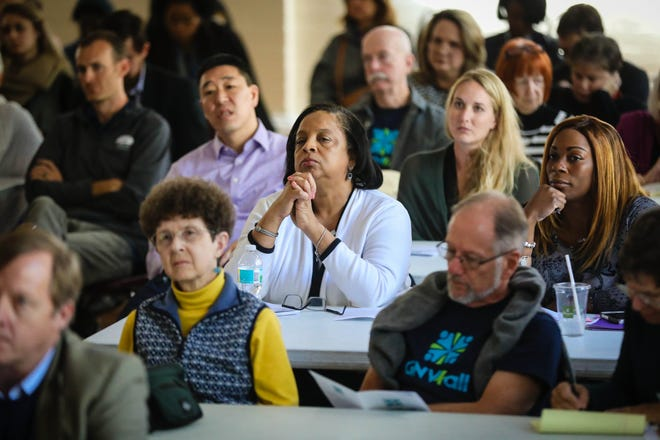 Attendees watch presentations being made at the Gainesville For All kickoff event in 2016.