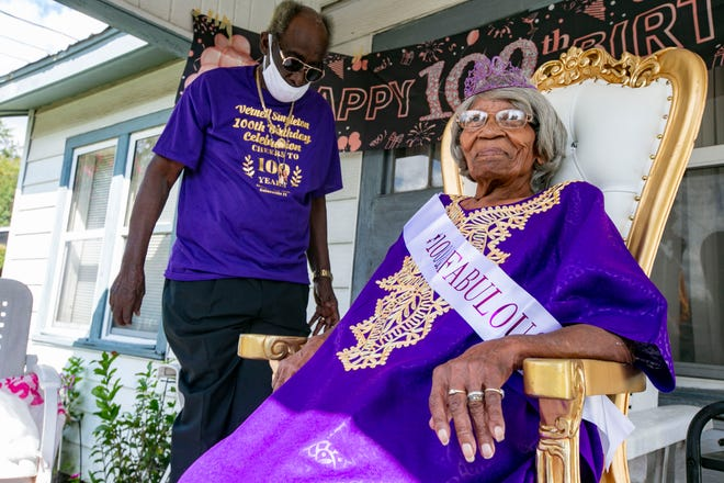 Vernell Singleton, who will turn 100 on Thursday (Oct. 7), celebrated her 100th birthday Saturday at her northeast Gainesville home. She is shown with her brother Jimmy Williams, 85, as she sits on the porch and friends and neighbors drove by offering well wishes and gifts. A few members of the Gainesville Police Department also drove by with lights and sirens. [Alan Youngblood/For The Guardian]