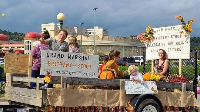 Great Pumpkin Parade Grand Marshal Brittany Stout was joined on her float by some young people tossing candy.