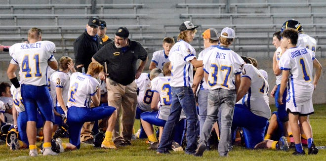Castlewood High School head football coach Doug Ruesink (left) looks on as assistant coach Dan Haug speaks to the team's players after a game last fall at Watertown Stadium. Castlewood (5-1) visits top-rated De Smet (6-0) in a battle of Class 9A teams at 7 p.m. on Thursday.