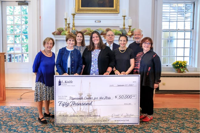 Sheehan Family Companies SVP Deb Lahteine, center, presents ceremonial check for $50,000 grant to Plymouth Center for the Arts. From left: Kathy Dunn, Peg Page, PCA board president; Eileen Pacheco; Deb Lahteine; Paul Blanchard; Carla Crawley, daughter of PCA cofounder Elaine Crawley; Richard Mulcahy; and Carol Marshall.