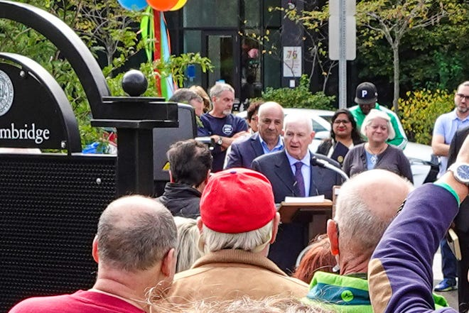 Councilor Tim Toomey, who is not seeking re-election this November, speaks during a ceremony dedicating a park on Rogers Street in his honor in East Cambridge.
