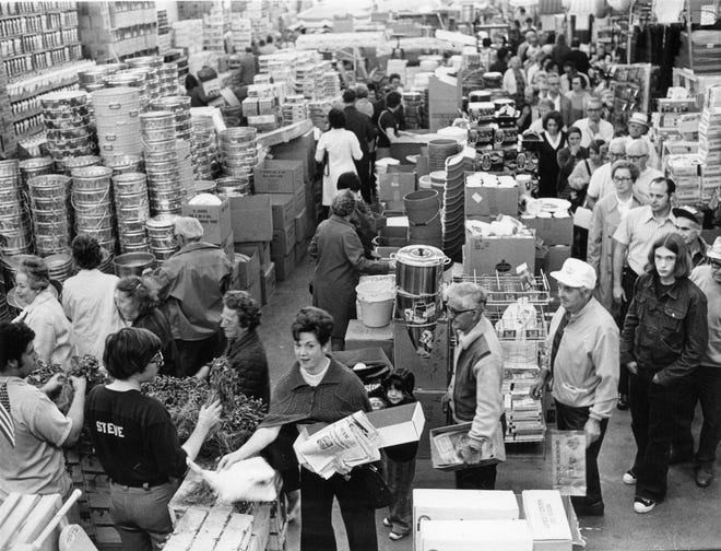 """The difference between the days when Spag's used to pass out free tomato plants (pictured here in 1973) and the 1951's """"The Day of the Triffids"""" is people used to wait in long lines for free tomato plants at Spag's while people hid for cover from killer vegetation in """"The Day of the Triffids."""""""