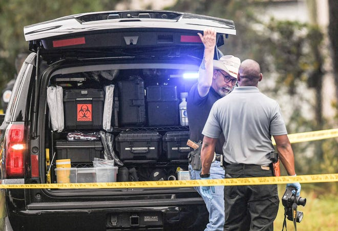 Anderson County Senior Investigator Deputy Coroner Don McCown, left, talks with Deputy Coroner Ty Blackwell, as they work the scene of a shooting death at US 29 and Griffin Road Belton, S.C. Monday, October 4, 2021.